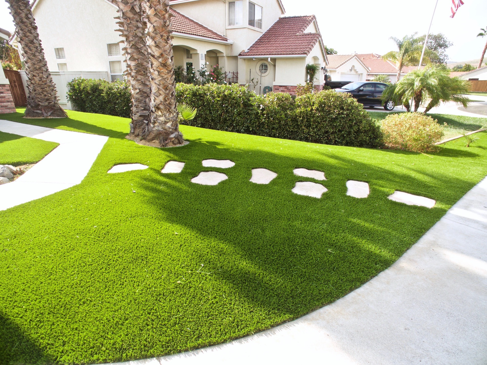 front yard lawn with synthetic grass artificial turf